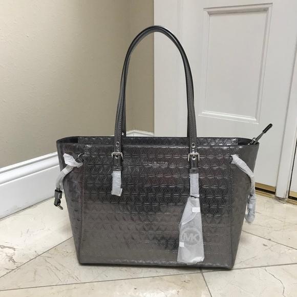 af22a8afa7af Michael Kors Silver Quilted Voyager Tote Bag  298